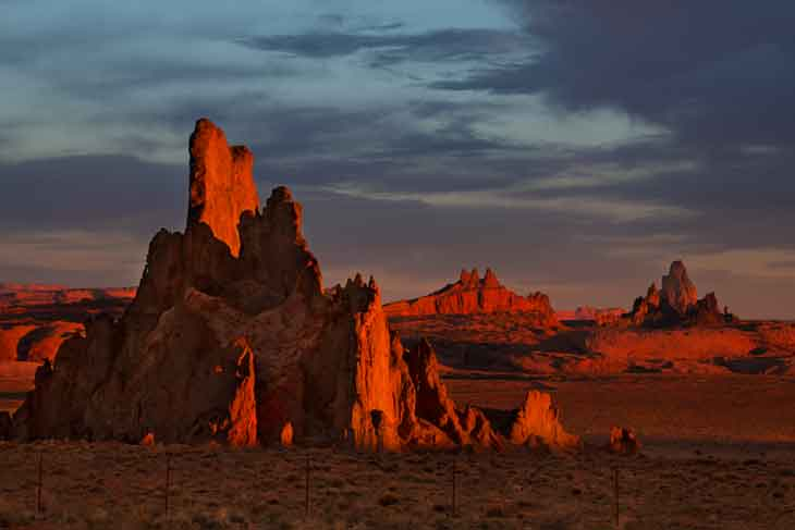 Church Rock in the high desert at sunrise on the Navajo Nation (at distant right is Agathla Peak)