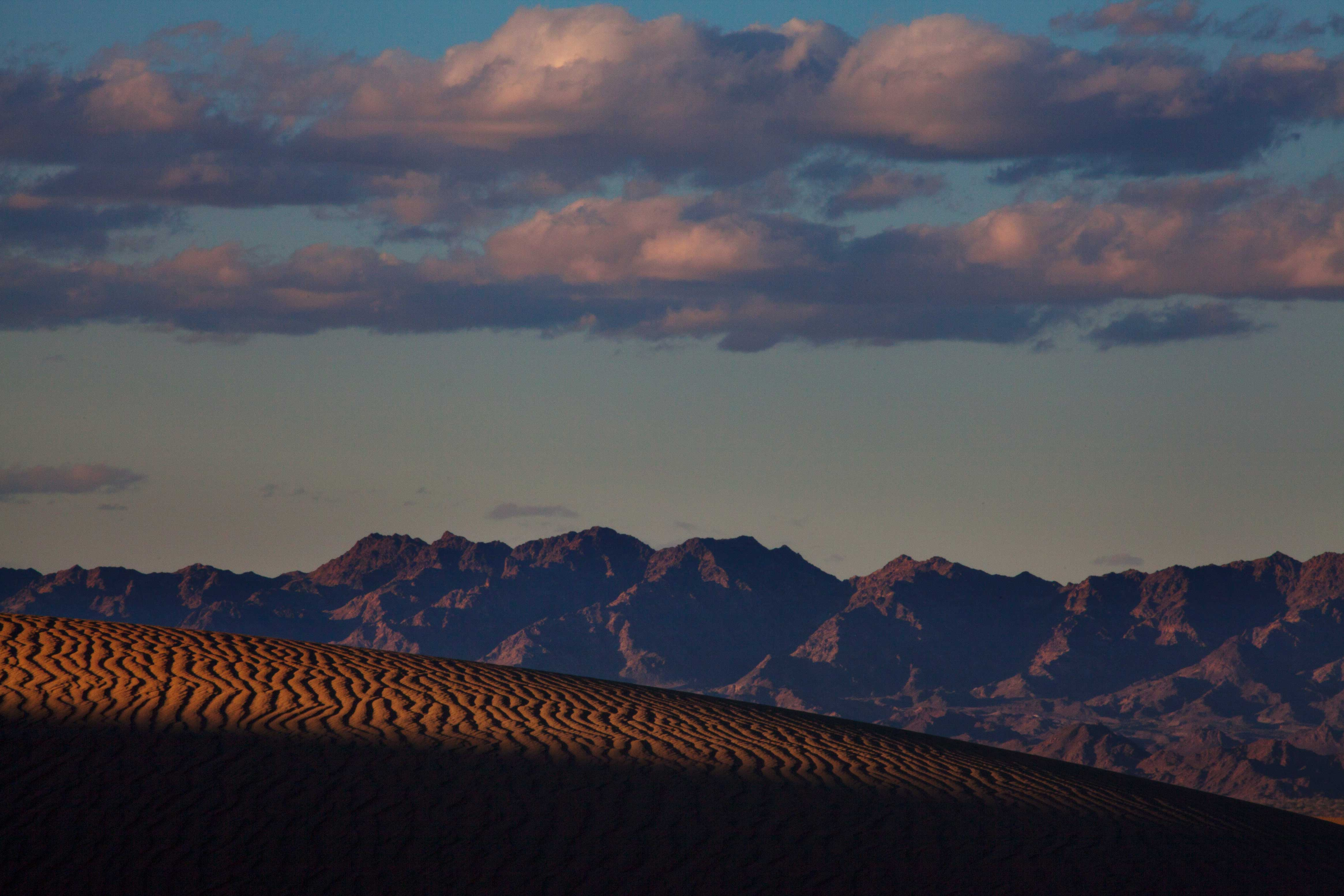 Imperial Sand Dunes (Algodones Dunes) in the southern California desert, with the Chocolate Mts. in the distance